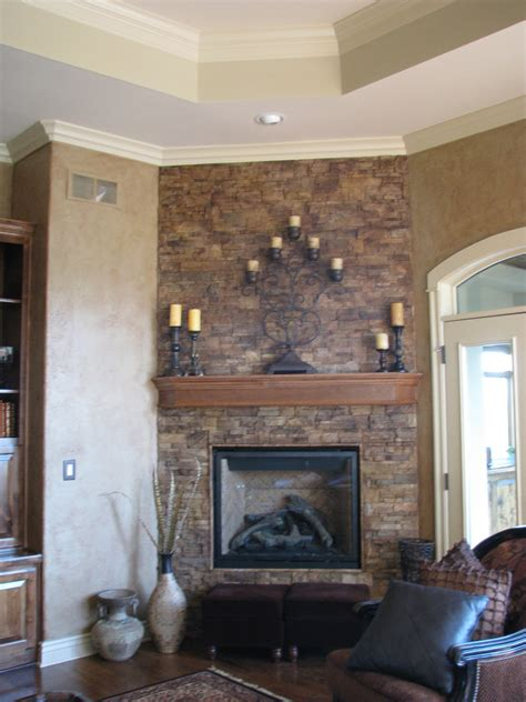 magnificent brick wall exposed black iron painted fireplace and wooden floating shelves as