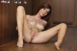 beautiful redhead mia sollis bares her sexy panties and spreads legs