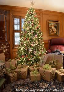 wrapping gifts with plaid ribbons and turning on christmas