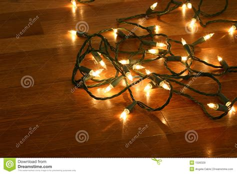 christmas lights on wood floor royalty free stock images