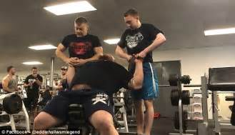 eddie hall bench press eddie hall lifts two grown men in the stoke on trent gym