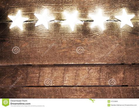 light rustic wood background and rustic background with lights and free text space fes