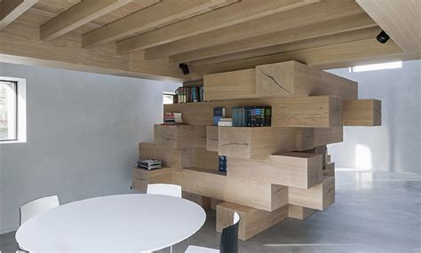 renovated furniture stacked timber beams act as multi use office furniture in