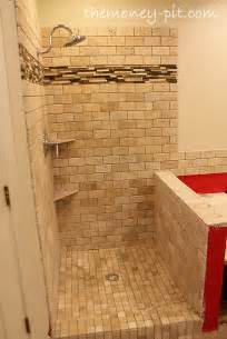 master bathroom week 6 tiling shower floor curb and knee