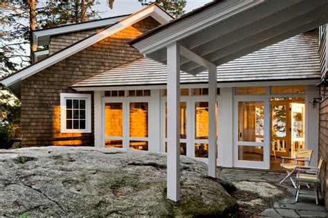 angled garage with mudroom between screened porch off bkfst for three season porch entry beach style exterior