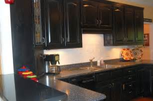 delightful Black Cabinets With Granite Countertops #1: distressed-black-cabinets-with-black-granite-countertops.jpg