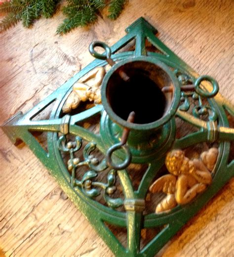 vintage christmas tree stand with cherub christmas gifts