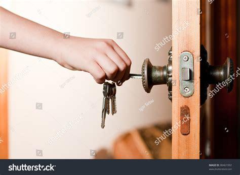 unlock door key download man driver unlocking or locking locking up or unlocking door with key in hand stock photo