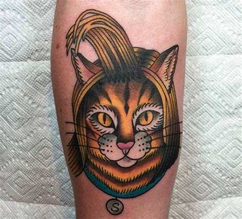 small cat face tattoo small style colored cat on forearm