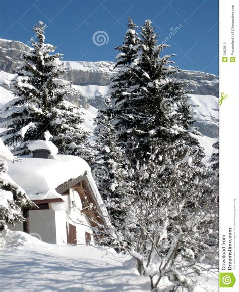swiss mountain home in snow royalty free stock photos