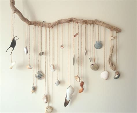 driftwood branch with hanging beach treasures mobile on wall kids of the wild