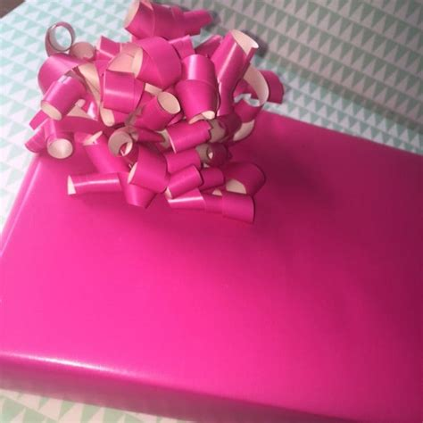 Bows Out Of Wrapping Paper - how to make a beautiful bow out of leftover wrapping paper