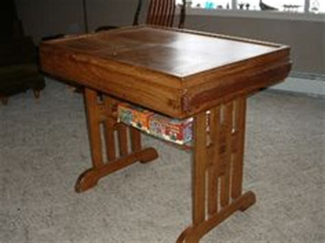 puzzle table with cover puzzle table would want it lower with closed cabinet for