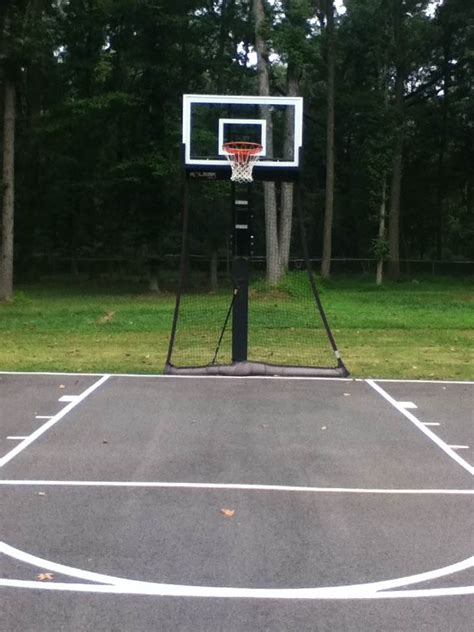 backyard basketball half court a backyard half court with striping is can be an inspiring early morning site