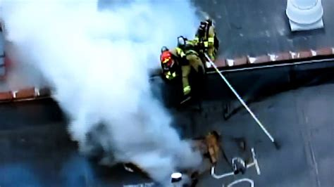 anaheim firefighter falls through roof fighter almost falls through roof and save by his