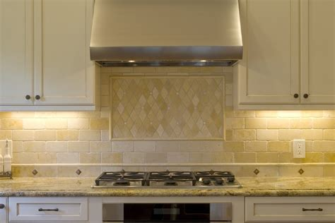 chic travertine backsplash in kitchen traditional with pattern tile next to alabaster