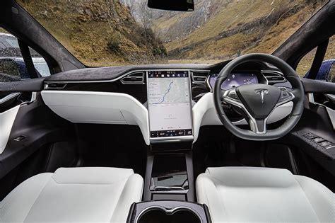 tesla inside 2017 tesla model x vs audi q7 vs range rover sport test
