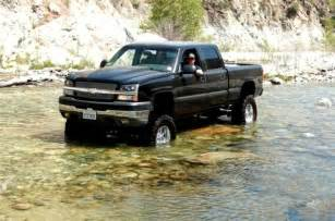 2003 chevy silverado jacked up trucks big rigs