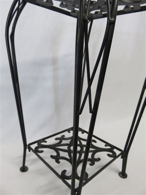 how black wrought iron adds definition to a living room transitional design online auctions black wrought iron