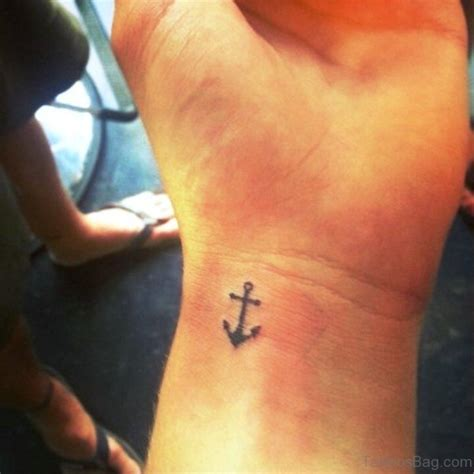 dainty cross tattoos dainty cross tattoos pictures to pin on tattooskid