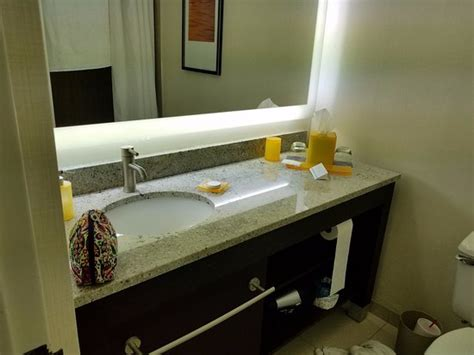 Corian Countertops Atlanta by Bathroom With Solid Surface Countertop And Backlit Mirror Picture Of Hyatt Regency Suites