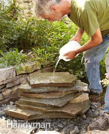 building a backyard waterfall backyard waterfall the family handyman