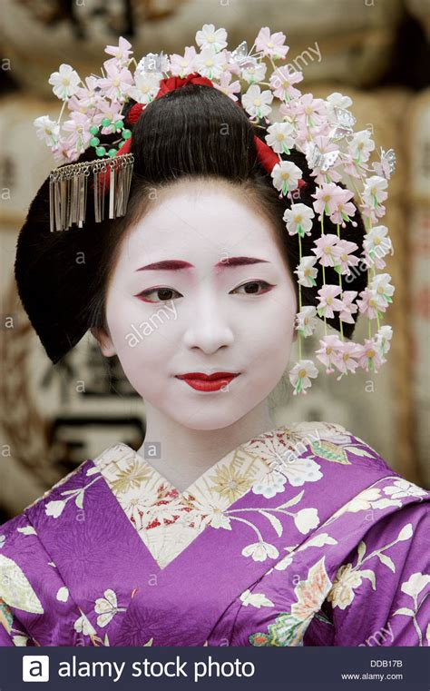 Kimono Maskara geisha in traditional make up and wearing a kimono in the gion stock photo royalty free image