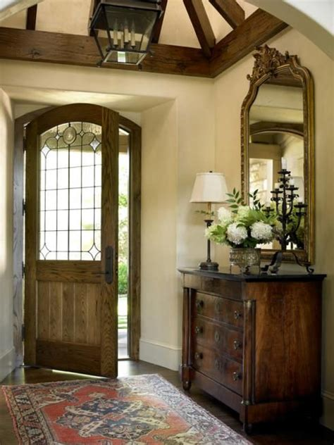 vaulted foyer feel to this foyer the chest mirror