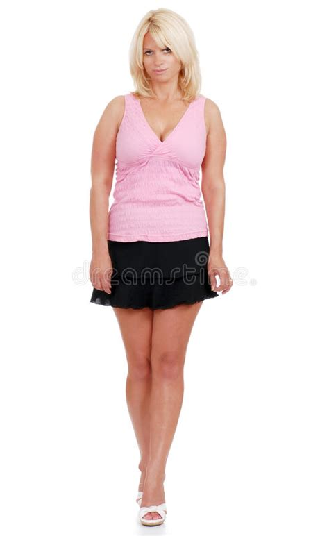 Donna Shorts wearing skirt and pink top stock photo