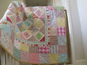 baby patchwork quilt pastel colours by aliceandflorence