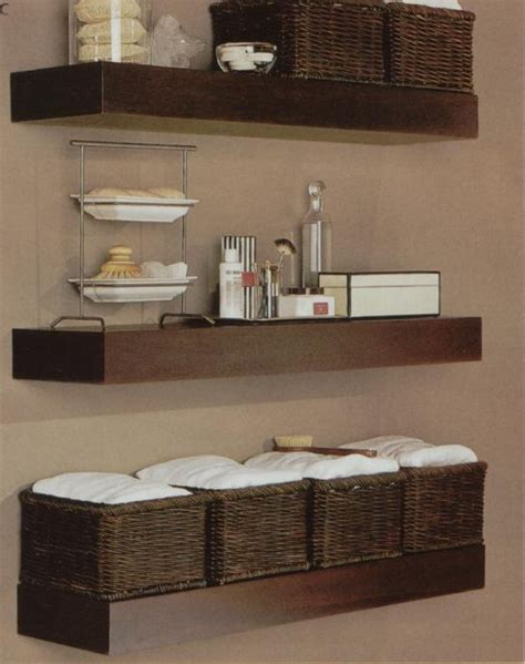bathroom shelves behind toilet pin by donna brown on home decor pinterest