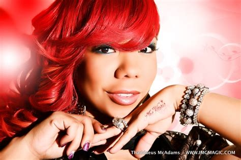 what hair product is tameka harris aka tiny using on her curly hair tameka tiny harris reps her kang with a new tattoo