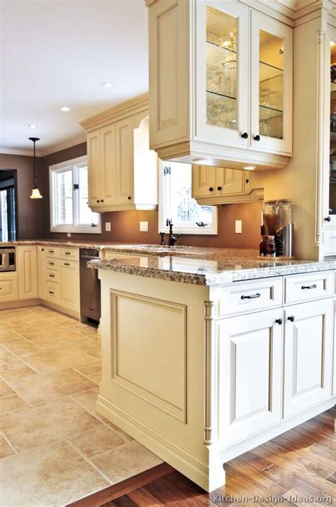 white kitchen cabinets tile floor traditional antique white kitchen cabinets brown wall