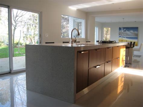 modern walnut cabinets modern kitchen white countertops walnut cabinets