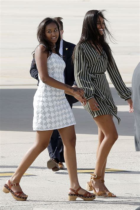 Barack Obama girls land in windy Madrid after jaunt to Liberia and Morocco   Daily Mail Online