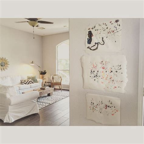 sherwin williams eider white displaying paint and leaves white rooms