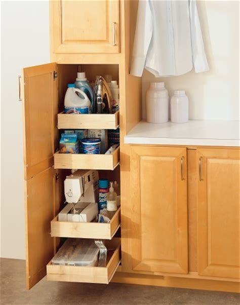 aristokraft utility cabinet with roll trays laundry room