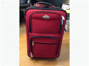 ricardo beverly hills carry on size red suitcase luggage