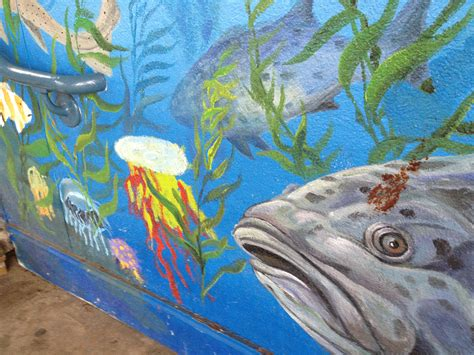 What Lies Beneath A Deferred santa pier aquarium mural reflects below and