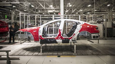 tesla factory how does tesla build its cars we ll show you roadshow