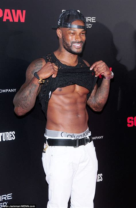 tyson beckford flashes his abs at the nyc premiere of
