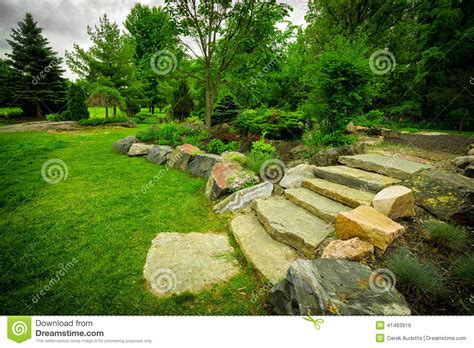 Stone Stairway On A Lush Green Garden Path Stock Image