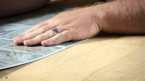 How to Lay Self Adhesive Vinyl Tiles : Working on Flooring