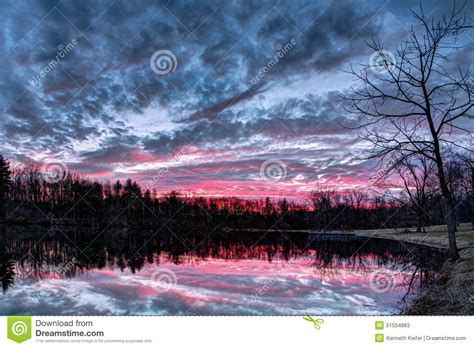 dramatic colors dramatic sunset pond stock photo image 51554883