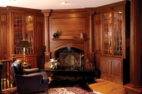 custom home decor handmade walnut library with fireplace and gun cabinets by