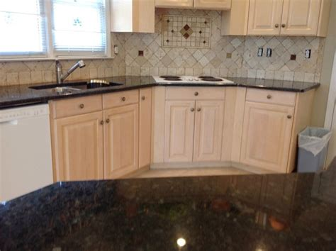 Granite Countertops With Light Wood Cabinets by Verde Peacock Granite On Light Wood Kitchen Cabinets