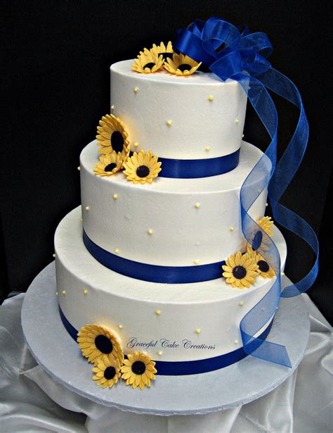 blue and yellow wedding cupcakes white buttercream wedding cake with royal blue