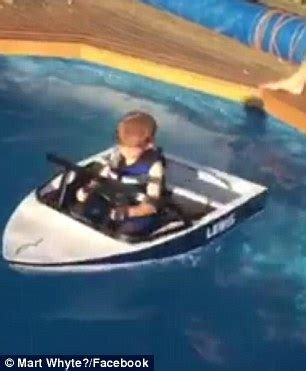 speed boat in pool australian kid glides across his pool in a homemade mini