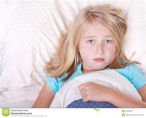 girl in bed sick girl laying in bed stock photo image 26292260