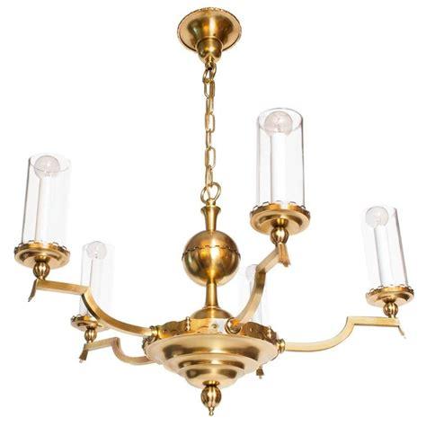 Scandinavian Chandeliers Scandinavian Modern Five Arm Brass Chandelier With Cylindrical Glass Shades For Sale At 1stdibs